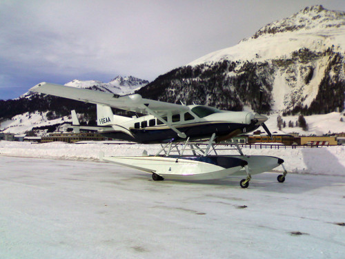 The Cessna C208 on the iced taxiway of Samedan, the airport of S. Moritz, the highest airport in Europe.